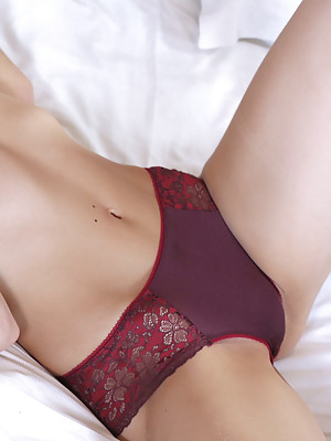 Izabella in sexy maroon bra and pantie set getting naked on bed